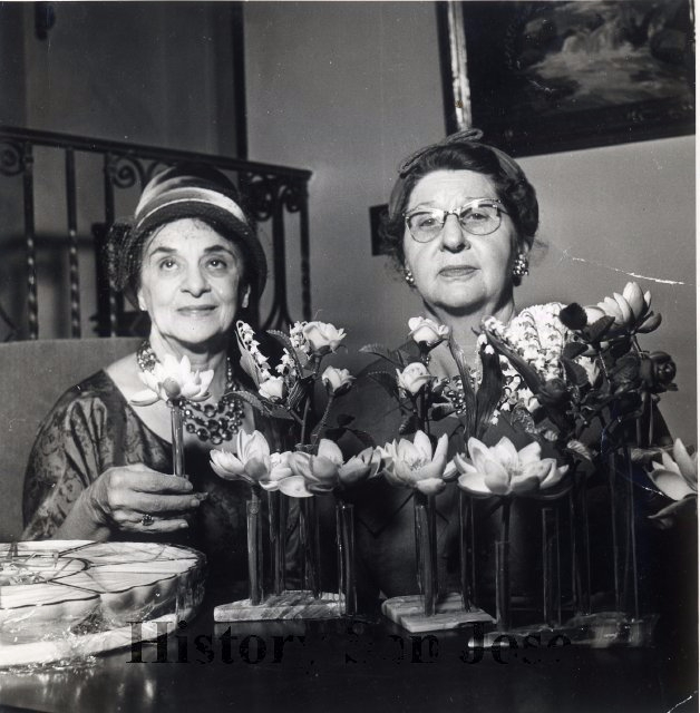 A photo of two women at an early SJWC event