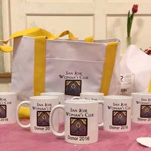 A photo of a tote bag and mugs, thank you gifts for contributions to the SJWC
