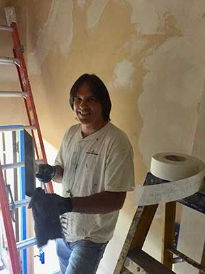 A man restoring the historic San Jose Woman's Club house